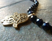 Navy goldstone hamsa necklace.