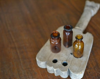 Collection of Three Amber Colored Bottles