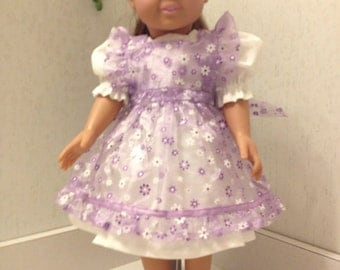 Delicate purple party dress with sheer daisy print pinafore