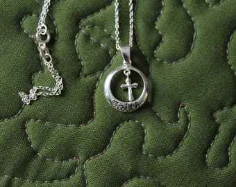 Sterling Circle Pendant, Bearing the word FAITH, With a Tiny Cross Inside the Circle