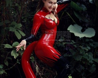 Sexy woman latex catsuit with inflatable tail