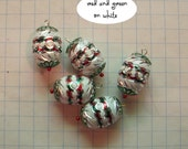 dollhouse scale or barbie christmas tree ornaments red and green on white ovals
