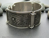 Wide sterling silver hinged link bracelet, secure clasp at the back primitive abstract etched pattern, the metal tattoo, hard to get off!