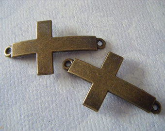 You will get 5 pcs Antique Bronze sideways cross charm connector