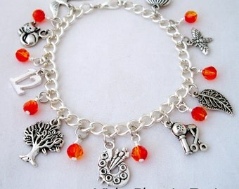 Hunger Games Inspired Charm Bracelet - Silver Charms and Swarovski Crystal Fire Beads - Jewelry inspired by Katniss, Peeta, District 12