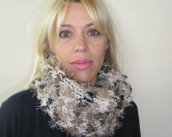 Handmade knitted beige scarf