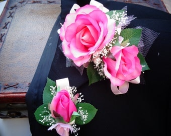 Corsage and matching boutonniere in hot pink roses