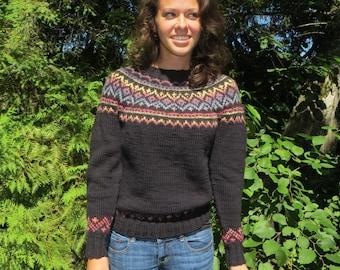 Woman's handknit black fair isle sweater in wool.