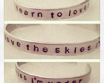 """Mumford and Sons aluminum bracelet """"learn to love the skies i'm under"""""""