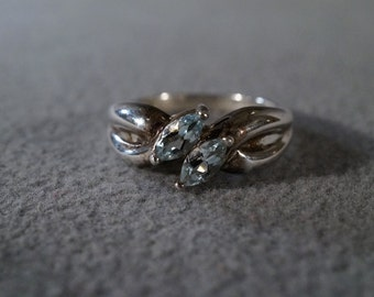 vintage sterling silver fashion ring with two side set marquise shaped blue topaz stones, size 7     M