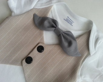 Baby Boy Bodysuit With A Tan Striped Vest Attached And A Grey Mustache Bow Tie.