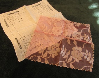 two vintage hankies, one white, one pink fancy