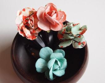 Paper flower hair clips