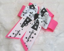 Cheer Bow - Hot Pink Glitter Background Bow with a Top Bow of White with Black Cheer Megaphones and a Black Glitter Center & Long Tails
