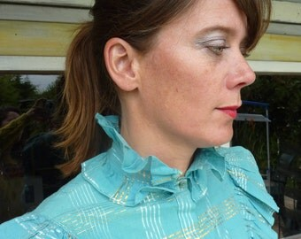 Light blue blouse with Ruffles and gold and silver thread