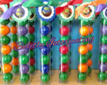 12 Ninja Turtle Themed Filled Gumball Favor Tubes with Ninja Turtle Character Tags. Green, Purple, Blue, Red and Orange Gumballs