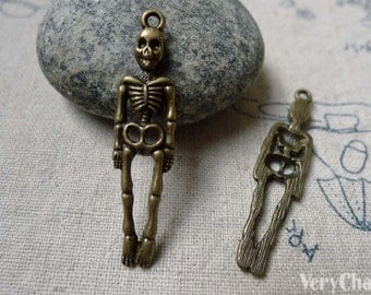 10 pcs of Antique Bronze Skeleton Charms 9x38mm A6020