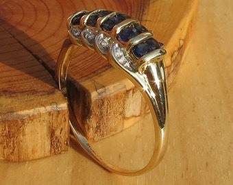 A vintage 9k yellow gold round cut sapphire and diamond ring