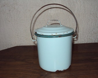 Small blue enameled iron pot dating back to the 1920s.