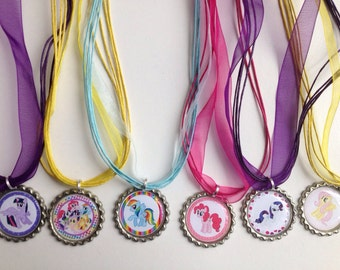 My little pony party favor necklaces.. My little pony.. Rainbow dash.. Rarity..pinky pie..Fluttershy.. My little pony party favors