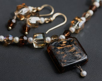 Studio made hot glass, pearl and crystal necklace and earrings.