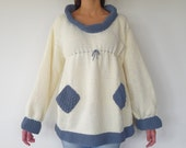 "The ""I'm so white it seems it's snowing on me right now"" hand knit blue and white sweater seeks an owner to enjoy winter. Are you tempted?"