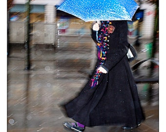 Long Black Coat. Blue umbrella In the Rain. Manchester