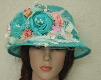 A Caribbean Green Sinamay Church Hat ,Bowler Derby Hat With Net And Sinamay Flowers