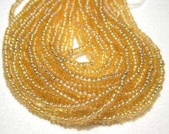 7 Grams Glass Seed Beads 11/0 Transparent Light Topaz AB