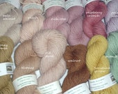 50g skein of organic wool yarn, DK thickness, gently plant-dyed, from our flock of Herefordshire Lleyn sheep. Spring offer: packs of 5x20g.