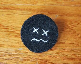 X Face Pin