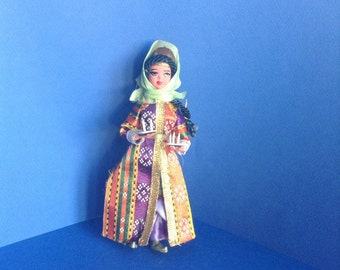 Vintage Turkish doll holding candle dishes