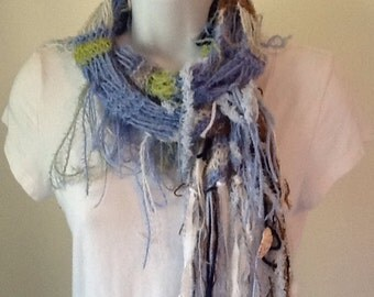 Extra long skinny fringy knitted scarf.