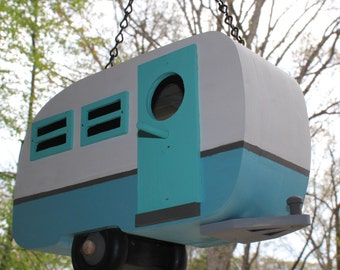Travel Trailer Birdhouse : solid wood, exterior paint, built to last. Compartment on the bottom easily opens for cleaning.