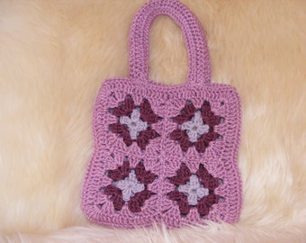 Unique handcrafted small granny square, tote/childs bag/ purse in 3 shades of pink. Crafted in Rico cotton DK yarn