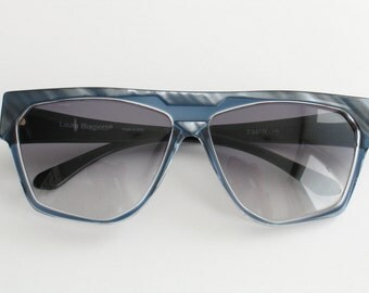 Laura Biagiotti  model T54/N women's sunglasses from the 80s. Colour bluish grey.