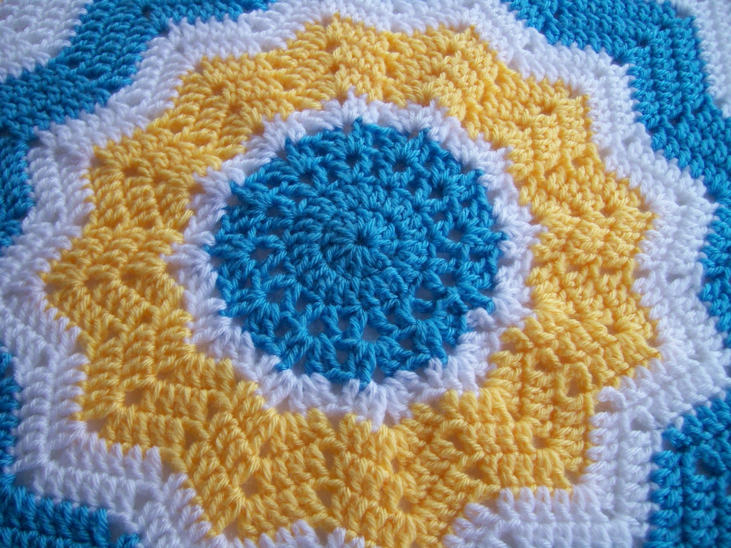 Crochet Pattern Round Ripple Afghan : Crocheted Round Ripple Baby Afghan in Blue Yellow and White