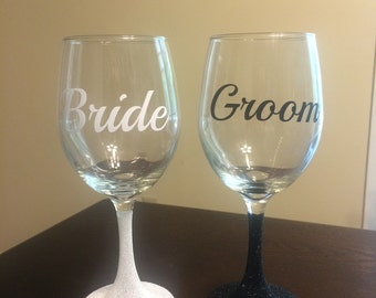 Custom personalized Bride and Groom wine glasses with glittered stems