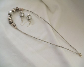 Silver coloured metal and glass beads with matching earrings