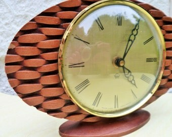 Very stylish 60s oval mantle Wood Clock.