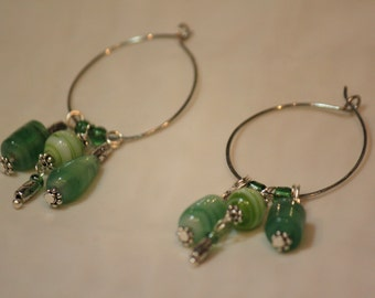 Sale 20% off. Regular 5.3, now 4.25....  Hoop earrings with dangle green glass beads