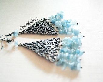 Earrings with large grey watermark and aquamarine pendants