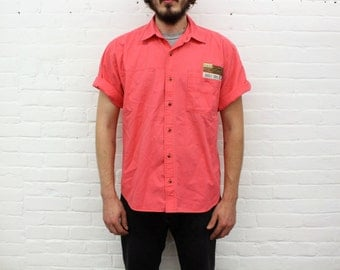 A Bright Little Bugle Boy .... vintage hot neon pink shirt from the 80's / 90's, size large