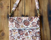 Helene. Large fold over crossbody bag with front pocket. Adjustable strap and size.