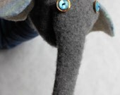 upcycled hand puppet.  button eye elephant.