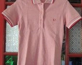 salmon pink heather Fred Perry polo with white and red striped trim on sleeves and collar - embroidered laurel - mod -