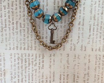 Brass Key Pendant Necklace with Blue and Gold Glass Beads and Chain