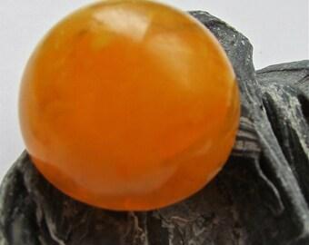 Round orange vintage bakelite clip earrings