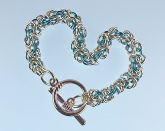 Aqua and silver chainmaille bracelet with a toggle clasp in Byzantine weave
