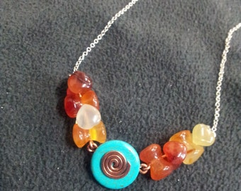 Boho blue and brown orange gemstone necklace with copper spiral.